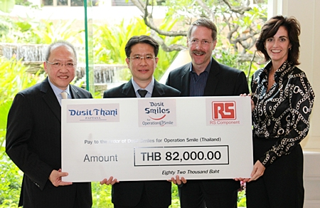 (L to R) Chatchawal Supachayanont, general manager of Dusit Thani Pattaya, Suthee Wetchapruekpitak of RS Components Company, Ltd., (Thailand), Kevin J. Beauvais, chairman of Operation Smile Thailand and Therese Beauvais, secretary of Operation Smile Thailand.