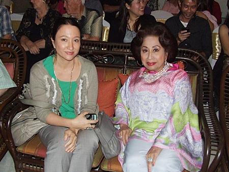 Kamala Sukosol (right) and her daughter Marisa enjoy the concert.
