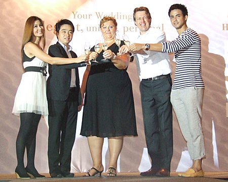 The organizers of the fair toast its success.