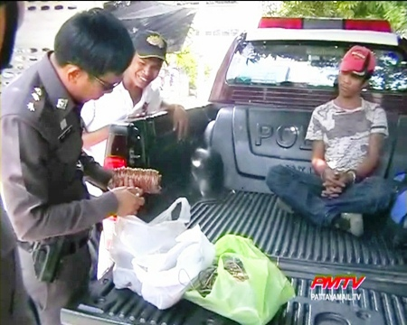 Police examine the lead, which will be used in evidence against the thief.