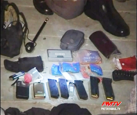 The haul of guns, ammunition and drugs are confiscated by the police.