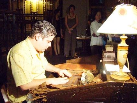 Hocnial Diaz Valdez demonstrates the fine art of cigar making.