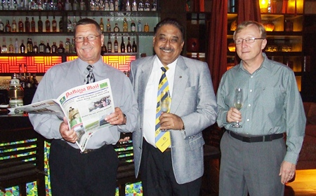 Robert flips through the Pattaya Mail presented to him by the publisher Peter Malhotra (centre). Bruce Hoppe (right), VP of Asia Operations Emerson was guest of honour to celebrate the American Independence Day.