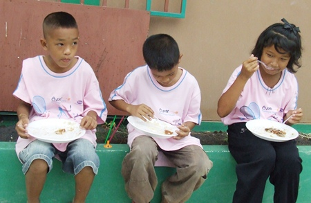 Youngsters enjoy a good meal before the show.
