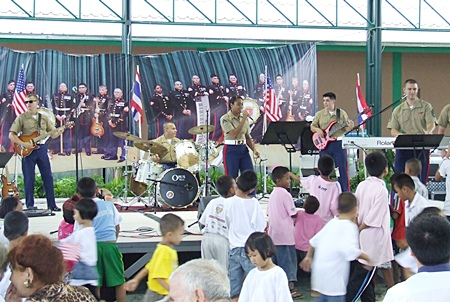 The U.S. Marine Corp band has everyone on their feet and dancing.