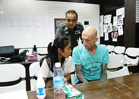 Hans-Georg Oliver Prager and Wanlada Klongtoklang are questioned down at the police station.