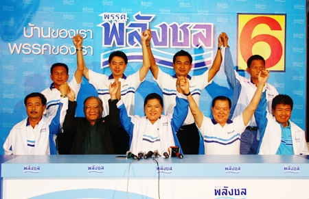 Palang Chon party members raise their hands in victory after winning 6 of 8 seats in Chonburi province.