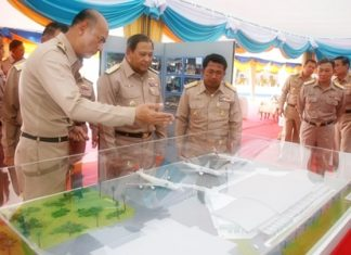Navy Commander in Chief Adm. Kamthorn Pumhiran (center) and high ranking officers inspect a model of the new facilities at U-Tapao Pattaya International Airport.