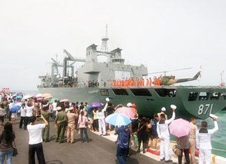 Family members wave goodbye as the Royal Thai Navy sets sail for Somalia.