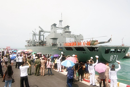 Family members wave goodbye as the Royal Thai Navy sets sail for Somalia.