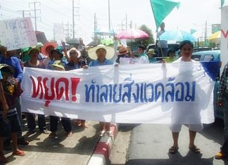 Rayong residents protest outside Integrated Refinery & Petrochemical Complex Co.'s Maptaput facility.