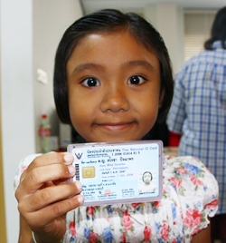7-year-old Sarocha Pachaporn smiles after receiving her first ID card.