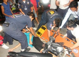 Sawang Boriboon Foundation rescue workers tend to the injured motorcycle accident victim, Somjai Kolansky.