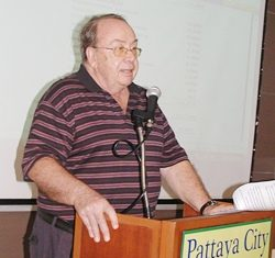 Chairman Michel de Goumois presents the report for the 2010 / 2011 year for Pattaya City Expats Club.