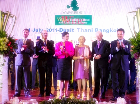 (L to R) Gregoire Debre, Director of Sopexa South East Asia; HE James Wise, Ambassador of Australia, and his wife, Teresa; HE Douglas Gibson, Ambassador of the Republic South Africa, and his wife, Pam (4th from left); and Joe Sriwarin, President of the Thailand Sommelier Association and Wine Professionals' Event.