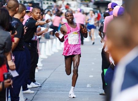 Lawrence Kiptoo Saina from Kenya crosses the line to win the men's 2011 Pattaya Asian King's Cup Marathon.