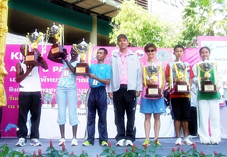 Road race winners receive their trophies from Pattaya Mayor Itthiphol Kunplome.