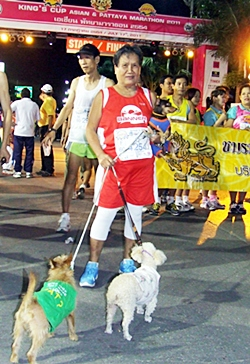 """Jae Ma"" (Auntie Dog) takes her furry friends for their annual run."