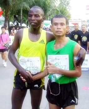 Men's half-marathon winner Thailand's Sanchai Namket (right) is congratulated by runner-up John Murikic Mwangi of Kenya.