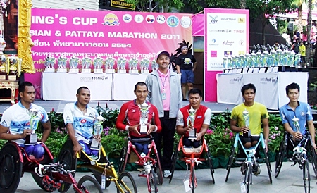 The wheelchair athletes proudly show off their trophies. The winner of the event, Prawat Wahoram, is far left of picture.