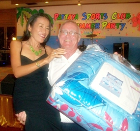 PSC President Tony Oakes gets some help with the raffle prizes.