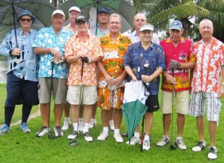 The garishly attired golfers assemble for a group photo at Emerald.
