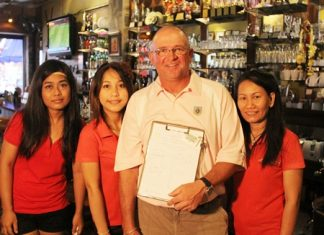 Brad Sproxton (2nd right) celebrates his win at Bangpra on Wednesday with the staff at The Golf Club.