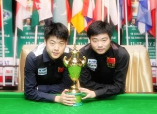 Ding Junhui and Liang Wenbo pose with the World Cup after defeating Northern Ireland in the final at the Bangkok Convention Centre, Sunday, July 17.