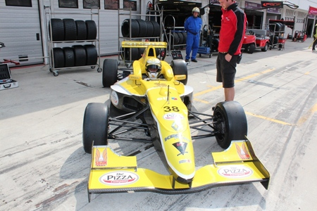 Sandy Stuvik sits in his car in the pit lane at the Hungaroring circuit just outside Budapest, Sunday, July 3.
