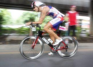 Woodlands Hotel & Resort's General Manager Stephane Bringer cycles during the Bangkok Triathlon, Sunday, July 10, 2011.