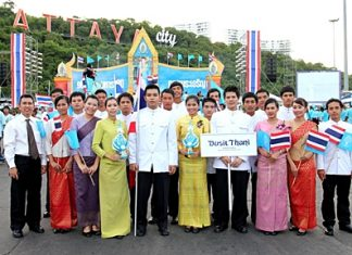 Thanathorn Phongsri (left), Human Resources manager of the Dusit Thani Pattaya together with the hotel staff took part in the parade along Beach Road ending at the Bali Hai pier where the city had arranged colorful celebrations in honor of her Majesty the Queen's 79th birthday on August 12.