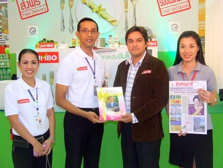 Marut Khutsumraan, store general manager Big C; Kamolthep Malhotra, general manager Pattaya Mail Publishing Co., Ltd.; and Supaporn Suwanphan, sales & marketing for Pattaya Mail Publishing Co., Ltd., at the grand opening.