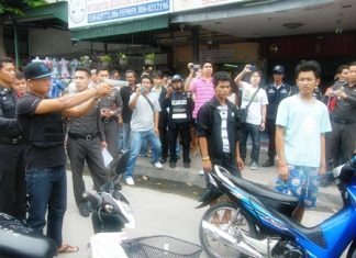 Angkul Srihanan shows police and onlookers how he allegedly murdered two men on the streets of Pattaya.