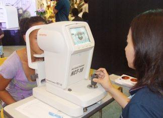 A Central Festival Pattaya Beach shopper is given a free eye check during Bangkok Hospital Pattaya's health fair.