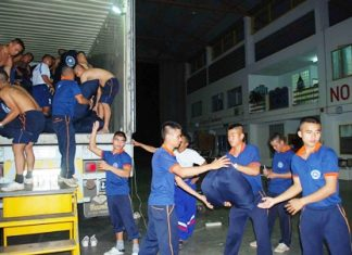 Many hands make light work - sailors from the Royal Thai Navy base in Sattahip load up supplies headed for flood stricken communities in Pichit.