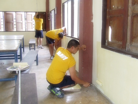 Sailors from the USS Cowpens apply a new coat of paint to the walls at Ban Thungkrad School in Banglamung.