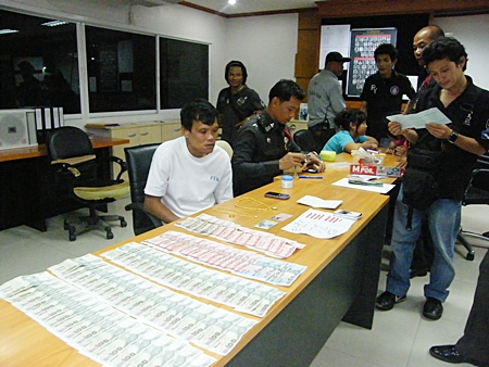 Somphan Kumphanyaem (seated, left) will be going through the court process one more time after being caught, again, selling illicit drugs.
