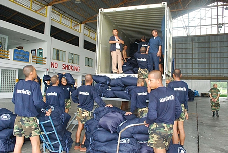 Sailors load up the containers for their long trip north.