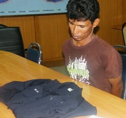 Charan stares forlornly at his Office of Narcotics Control Board uniform during his arrest for dealing drugs.