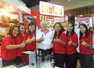John Pothecary (center) and his lovely and attentive team at the Pattaya Food & Hoteliers Expo 2011.