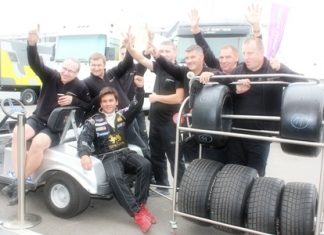 Sandy poses for a photo with his pit crew.
