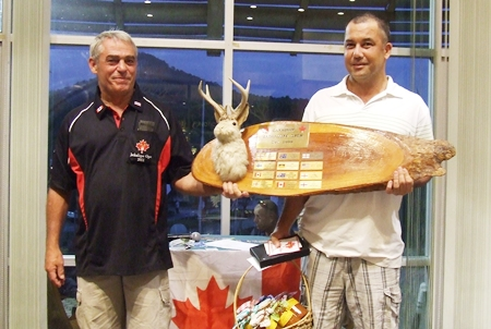 2011 Canadian Jackalope Champion Paul Daud (right) is handed the perpetual trophy by Dale Drader.
