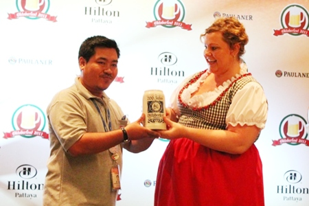 The Pattaya Mail's ace cameraman Montree Kotchawong won an authentic Munich stein at the press conference held Sept. 6 at the Hilton Pattaya.
