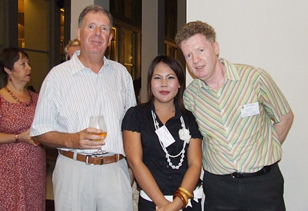 Call me irresistible, Chutima Thambun (Admin Assistant Pattaya Mail) is flanked by Dr. Alastair Acken and Raymond O'Reilly. (Lecturer, Asian University).