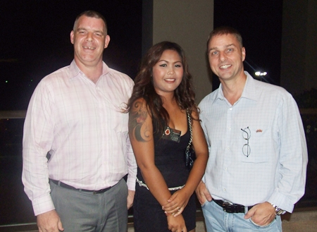(L to R) Joe Cox, Jutharat Champawong, office manager of Defence International Security Services, and Russell Jay Darrell, managing director of Soundzgood Co., Ltd.