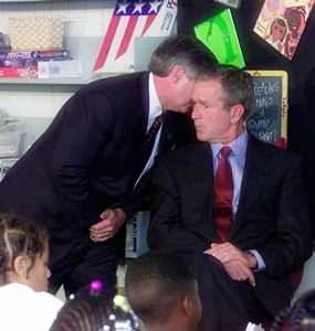 Chief of Staff Andy Card whispers into the ear of President George W. Bush to give him word of the plane crashes into the World Trade Center, during a visit to the Emma E. Booker Elementary School in Sarasota, Fla. (AP Photo/Doug Mills)