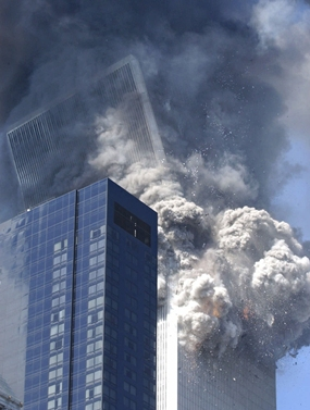 The south tower of the World Trade Center begins to collapse after a terrorist attack on the New York landmark. (AP Photo/Amy Sancetta)
