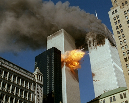 United Airlines Flight 175 collides into the south tower of the World Trade Center in New York as smoke billows from the north tower. (AP Photo/Chao Soi Cheong)