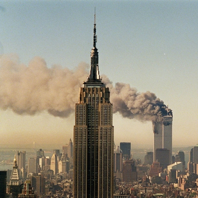 The twin towers of the World Trade Center burn behind the Empire State Building in New York. (AP Photo/Marty Lederhandler, File)