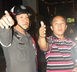 Wichai Tuengjeamsri tries to explain to police what happened.